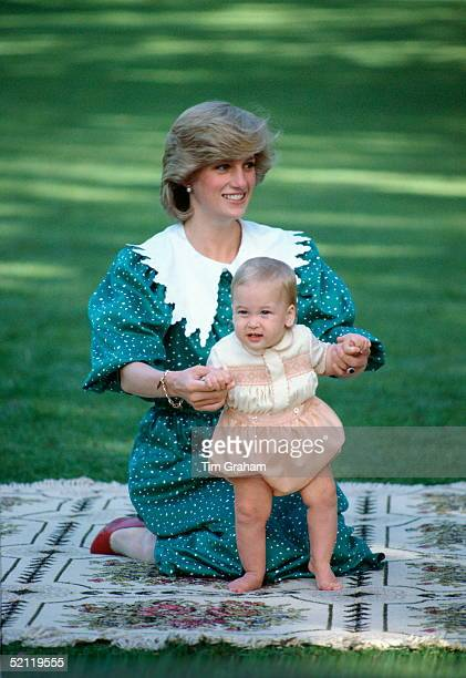 Diana Princess Of Wales Sitting On A Blanket Holding Her Baby Son Prince William So He Can Take His First Steps During A Photocall Part Of His...