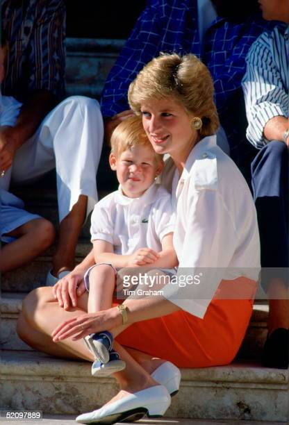 Diana Princess Of Wales Sitting On The Steps Of The Marivent Palace With Her Son Prince Harry Sitting On Her Lap At A Photocall During Their Summer...