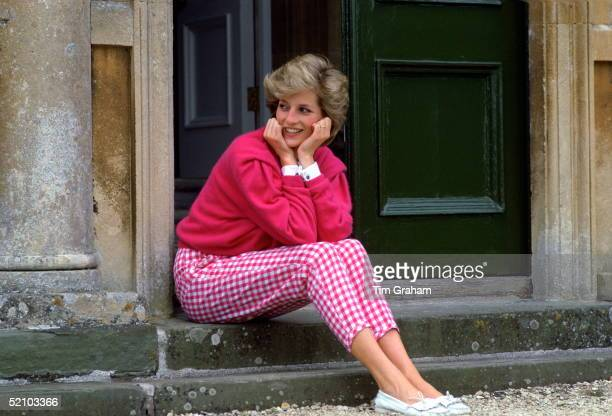 Diana Princess Of Wales Sitting On The Steps Outside Her Country Home Highgrove The Princess Is Casually Dressed In Pink Gingham Trousers With A...