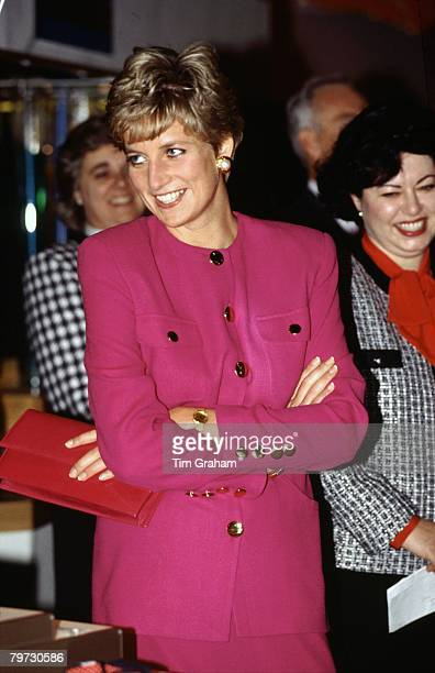 Diana Princess of Wales smiling during her visit to Sudbury part of her official tour of Canada The Princess is wearing a pink suit designed by...