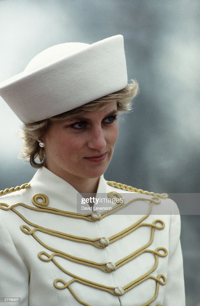 Diana Princess of Wales, takes the salute at the Sovereigns Parade at the Royal Military Academy on April 10, 1987 in Sandhurst, Berkshire, England.The Princess wore a military style outfit designed by Catherine Walker, with a hat by Graham Smith at Kangol.