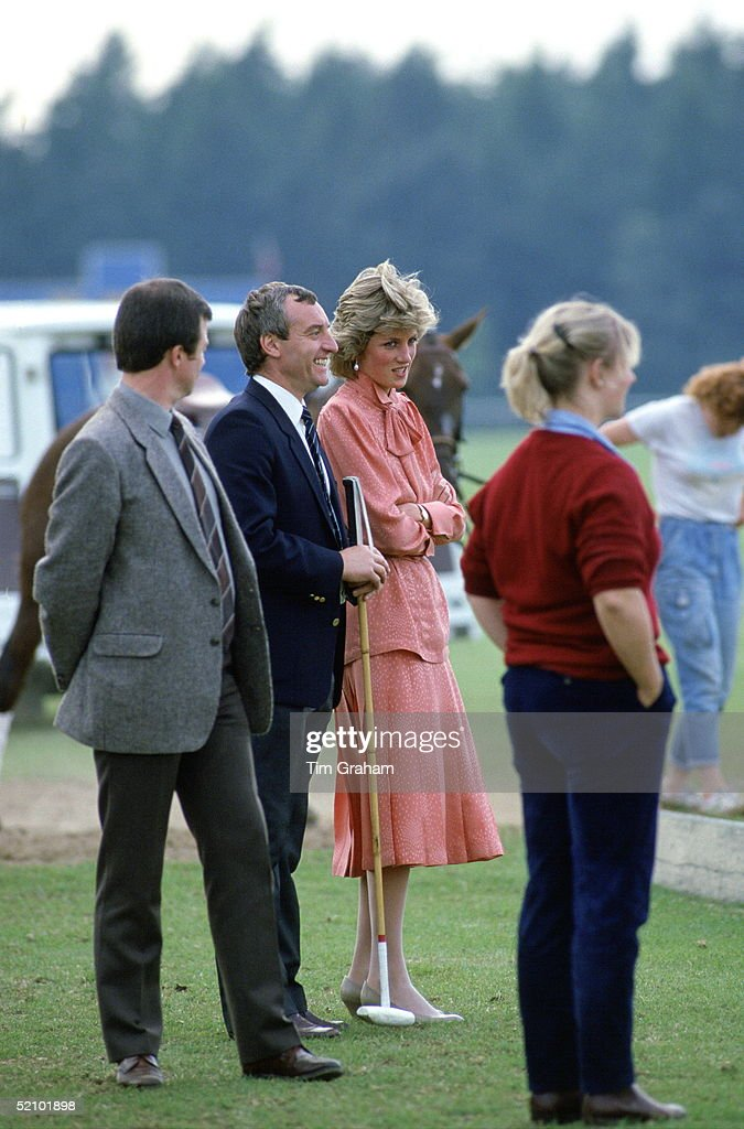 Diana, Princess Of Wales, Talking With Her Police Bodyguard, Barry Mannakee, Whilst Watching A Match At Guards Polo Club,smiths Lawn,windsor After Spending The Day At Royal Ascot. The Princess Is Wearing A Peach-coloured Suit Designed By Jan Vanvelden.