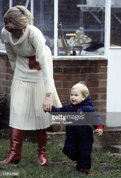 Diana Princess of Wales walks with a young Prince William in the gardens of Kensington Palace on December 14 1983 in London England
