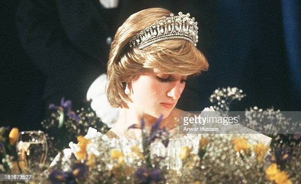 Diana Princess of Wales wearing the Queen Mary Tiara attends a banquet on June 15 1983 in Nova Scotia Canada