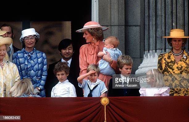 Diana Princess of Wales carries baby Prince Harry as she stands on the balcony of Buckingham Palace following Trooping the Colour with Prince William...