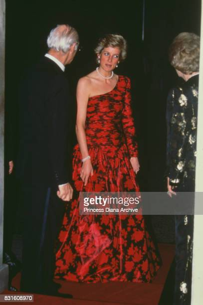 Diana Princess of Wales wearing a red and black Catherine Walker evening dress attends a dinner at 10 Downing Street with prime minister Margaret...