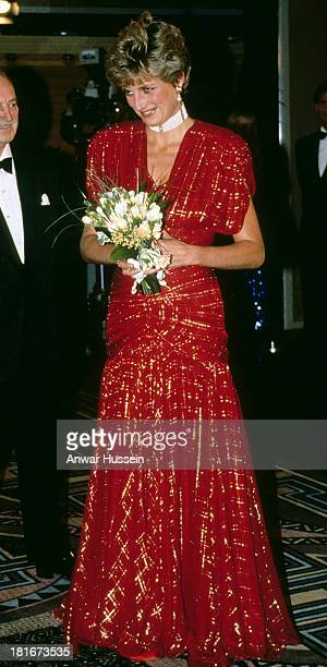 Diana Princess of Wales wearing a Bruce Oldfield red glitter gown attends the film premiere of the film 'Hot Shots' in Leicester Square on November...