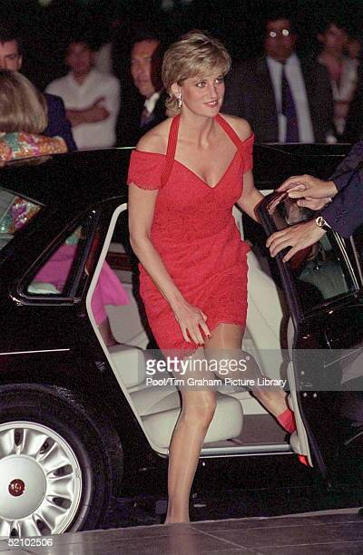 Diana Princess Of Wales Wearing A Short Red Lace Cocktail Dress Arriving For A Dinner During Her Tour Of Argentina The Princess Is Pulling Down Her...