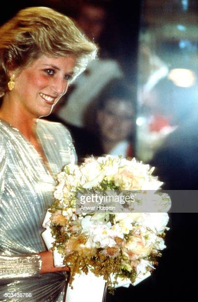 Diana Princess of Wales wearing a shimmering lame silver dress designed by Bruce Oldfield attends a film premiere during a tour of Australia on...