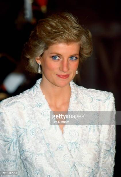 Diana Princess Of Wales Wearing A White And Blue Lace And Sequin Evening Coatdress Designed By Catherine Walker For A Dinner At The Chateau De...