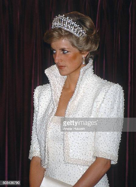 Diana Princess of Wales wears the Cambridge Lover's Knot tiara and a white outfit by Catherine Walker known as the 'Elvis Look' during a tour of Hong...