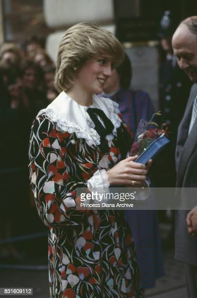 Diana Princess of Wales wearing a white red and black floral dress in Brixton London November 1983