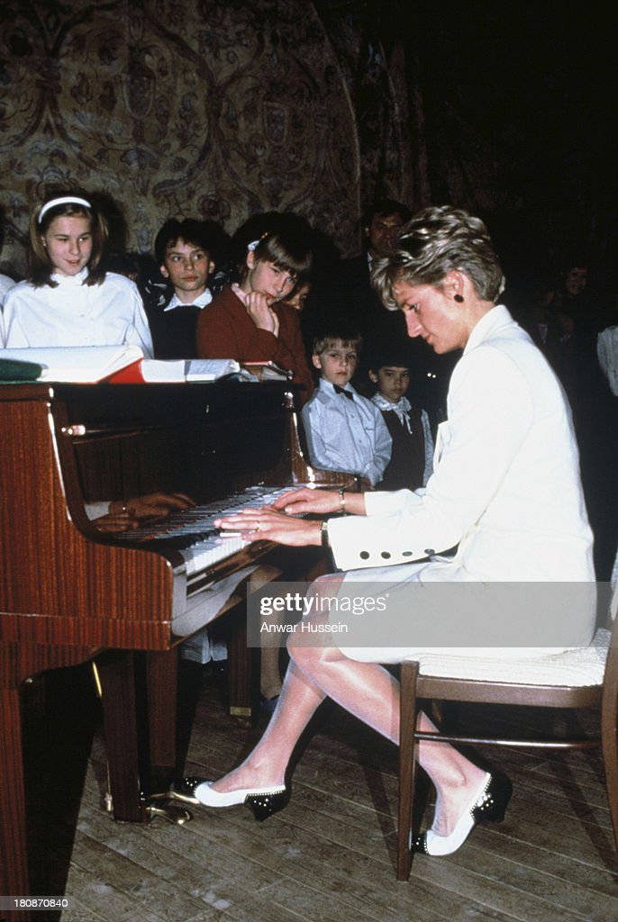 Diana Princess of Wales plays the piano during a visit to a children's hospital on May 01, 1991 in Prague, Czech Republic.