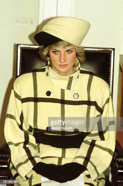 Princess Diana wear a coat designed by Escada and a hat by Philip Somerville during a visit to Berlin Germany in 1987