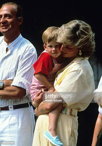 Princess Diana Princess of Wales hugs baby Prince Harry on holiday in Majorca Spain on August 10 1987 Also present were the Spanish Royal Family and...