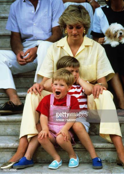 Princess Diana Princess of Wales with sons Prince William and Prince Harry on holiday in Majorca Spain on August 10 1987 Also present were the...