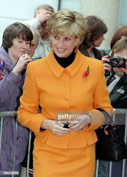 Diana Princess of Wales wearing an orange suit by Versace visits Liverpool on November 07 1995 in Liverpool England