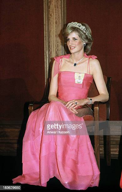 Diana Princess of Wales wearing the Spencer family tiara and diamond and sapphire jewels given to her by the Crown Prince of Saudi Arabia and a pink...