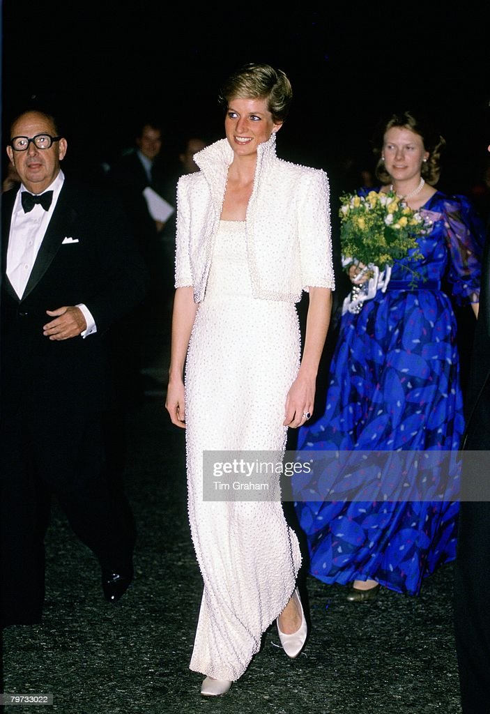 Diana, Princess of Wales wears a white Catherine Walker gown, known as the Elvis dress, with matching bolero jacket to the British Fashion Awards at the Royal Albert Hall, The Princess is accompanied by her lady-in-waiting Alexandra Loyd, This dress was lot number 78 at the Chrisites Dress Auction