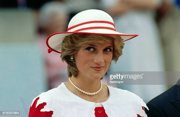 Diana Princess of Wales wears an outfit in the colors of Canada during a state visit to Edmonton Alberta with her husband