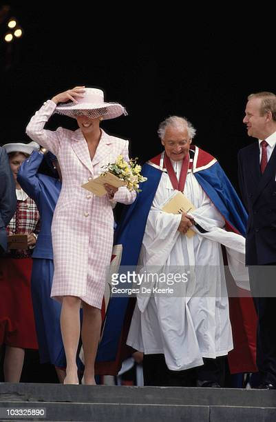 Diana Princess of Wales with a member of the clergy circa 1990