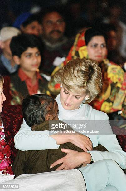 Diana Princess of Wales with a young pakistani child on her lap at the Shaukat Khanum Memorial Hospital Lahore Pakistan