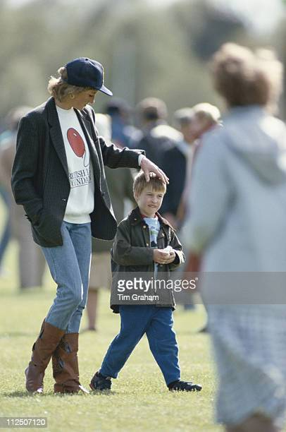 Diana Princess of Wales with her son Prince William attending a polo match at the Guards Polo Club in Windsor Berkshire England Great Britain 2 May...
