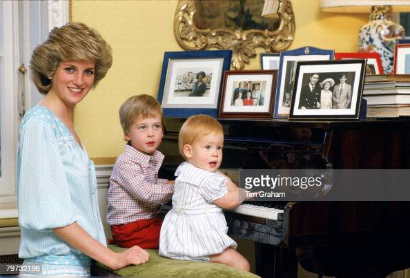 Diana Princess of Wales with her sons Prince William and Prince Harry at the piano in Kensington Palace