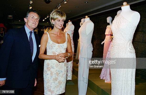 Diana Princess of Wales with Lord Hindlip Chairman of Christies International who will auction the dresses at the preauction party at Christie's New...