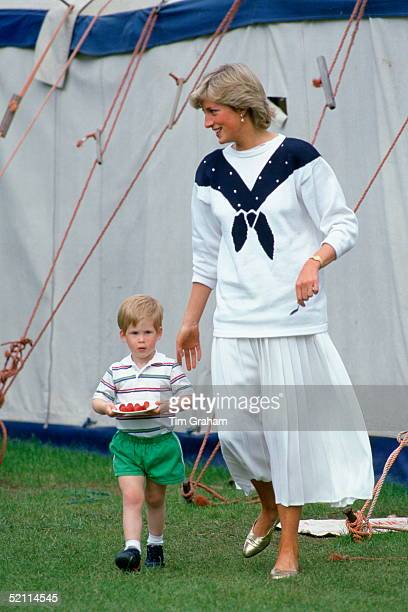 Diana Princess Of Wales With Prince Harry Carrying A Plate Of Strawberries She Is Wearing A Jumper By Fashion Designerroland Klein And A White...
