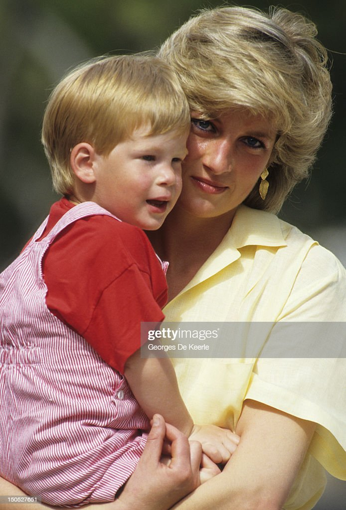 Diana, Princess of Wales with <a gi-track='captionPersonalityLinkClicked' href=/galleries/search?phrase=Prince+Harry&family=editorial&specificpeople=178173 ng-click='$event.stopPropagation()'>Prince Harry</a> on holiday in Majorca, Spain on August 10, 1987.