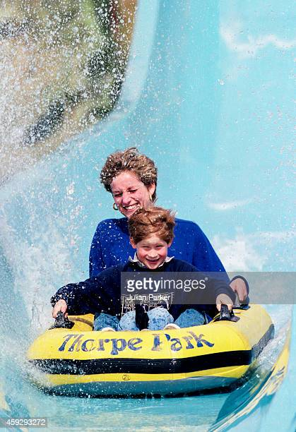 Diana Princess of Wales with Prince Harry on the Depth Charge ride at Thorpe Park Theme Park on April 18 1992 in Chertsey United Kingdom
