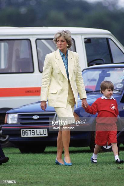 Diana Princess of Wales with Prince William attends a polo match at Smiths Lawn on May 31 1987 in Windsor Great Park Berkshire England Diana wore a...