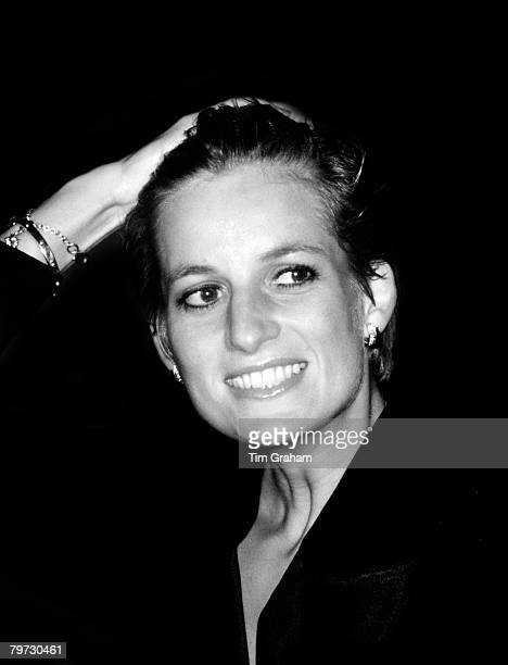 Diana Princess of Wales with wet hair having been soaked by heavy rain at an outdoor Pavarotti concert in Hyde Park