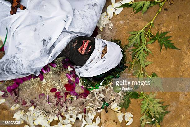 Diana R who claims to be possessed by spirits cries during a ritual of exorcism performed by Hermes Cifuentes on 28 May 2012 in La Cumbre Colombia...