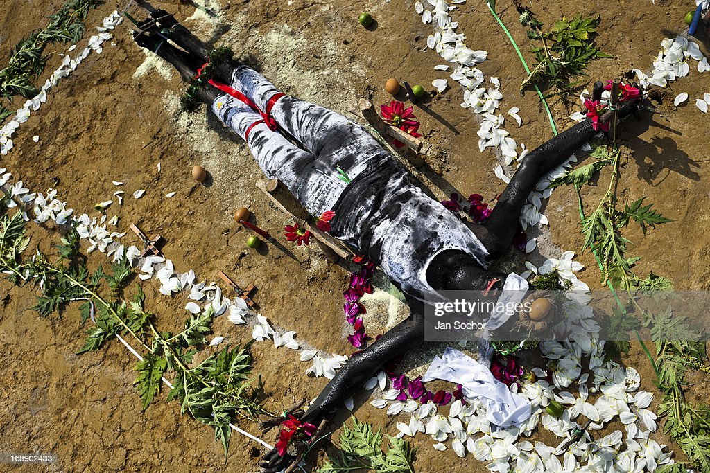 Diana R., who claims to be possessed by spirits, lies on the ground surrounded by flowers during a ritual of exorcism performed by Hermes Cifuentes on 28 May 2012 in La Cumbre, Colombia. Exorcism is an ancient religious practice of evicting spirits, generally called demons or evil. Although the formal catholic rite of exorcism is rarely seen and must be only conducted by a designated priest, there are many pastors and preachers in Latin America performing exorcism ceremonies. The 52-year-old Brother Hermes, as the exorcist calls himself, claims to have been carrying out the healing rituals for more than 20 years. Using fire, dirt, candles, flowers, eggs and other natural-based items, in conjunction with Christian religous formulas, he attempts to drive the supposed evil spirit out of a victim's mind and body.