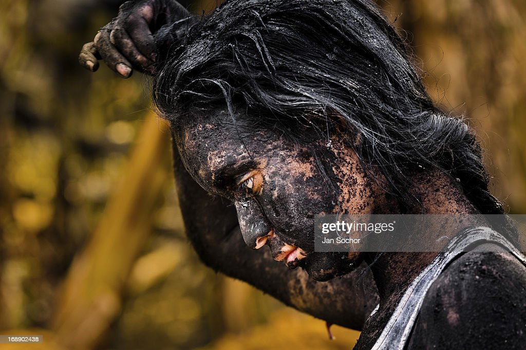 Diana R., who claims to be possessed by spirits, remains covered by black mud after a ritual of exorcism performed by Hermes Cifuentes on 28 May 2012 in La Cumbre, Colombia. Exorcism is an ancient religious practice of evicting spirits, generally called demons or evil. Although the formal catholic rite of exorcism is rarely seen and must be only conducted by a designated priest, there are many pastors and preachers in Latin America performing exorcism ceremonies. The 52-year-old Brother Hermes, as the exorcist calls himself, claims to have been carrying out the healing rituals for more than 20 years. Using fire, dirt, candles, flowers, eggs and other natural-based items, in conjunction with Christian religous formulas, he attempts to drive the supposed evil spirit out of a victim's mind and body.