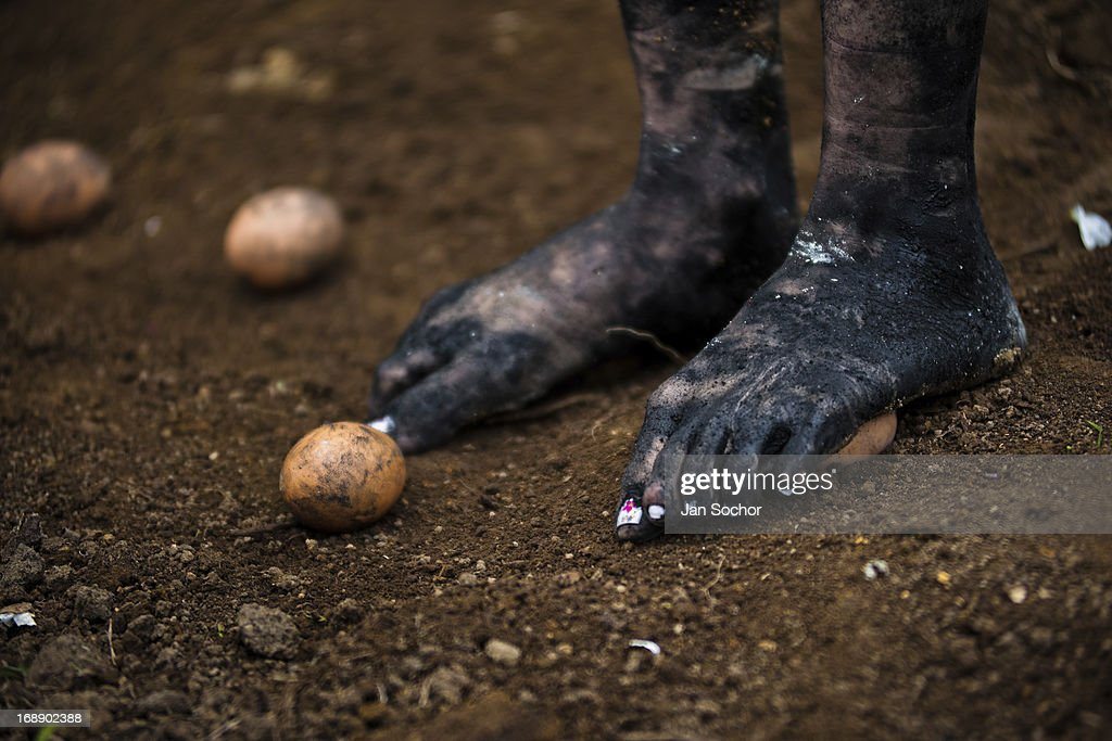 Diana R., who claims to be possessed by spirits, steps on eggs during a ritual of exorcism performed by Hermes Cifuentes on 28 May 2012 in La Cumbre, Colombia. Exorcism is an ancient religious practice of evicting spirits, generally called demons or evil. Although the formal catholic rite of exorcism is rarely seen and must be only conducted by a designated priest, there are many pastors and preachers in Latin America performing exorcism ceremonies. The 52-year-old Brother Hermes, as the exorcist calls himself, claims to have been carrying out the healing rituals for more than 20 years. Using fire, dirt, candles, flowers, eggs and other natural-based items, in conjunction with Christian religous formulas, he attempts to drive the supposed evil spirit out of a victim's mind and body.