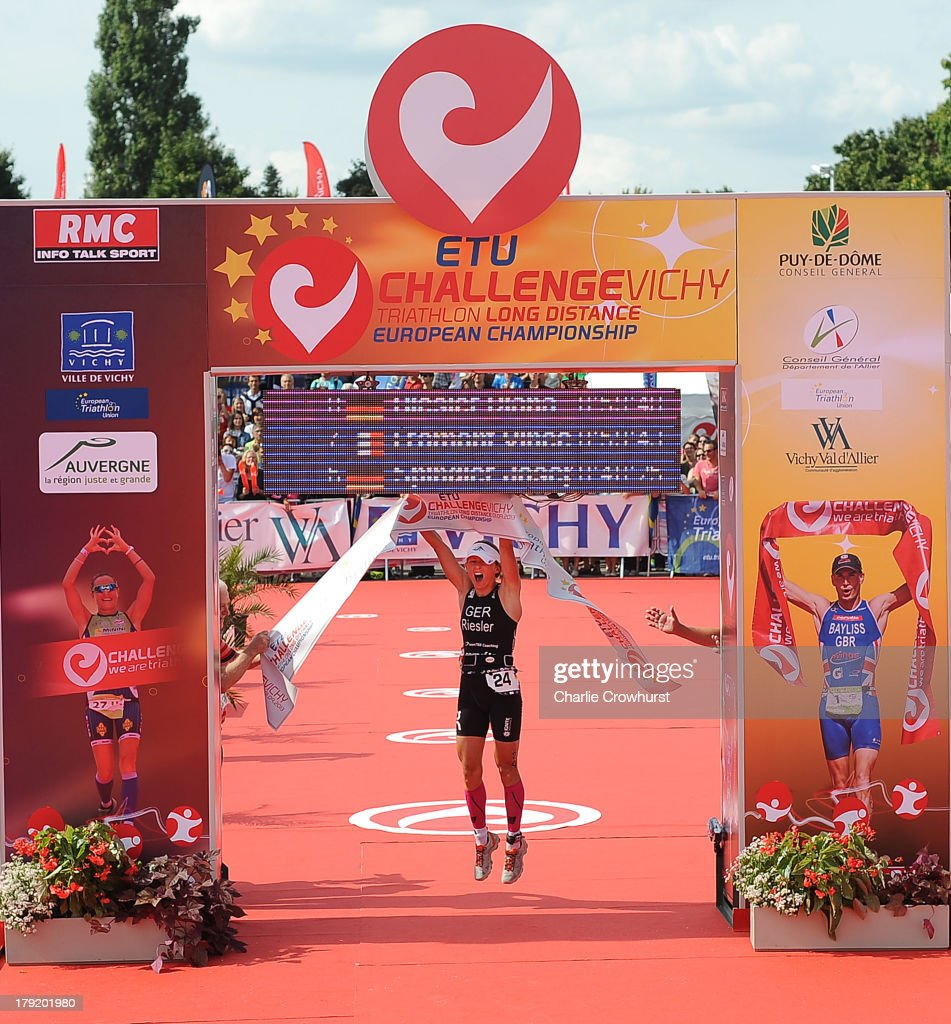 Diana Riesler of Germany celebrates winning the womens race during the Challenge Triathlon Vichy on September 01, 2013 in Vichy, France.