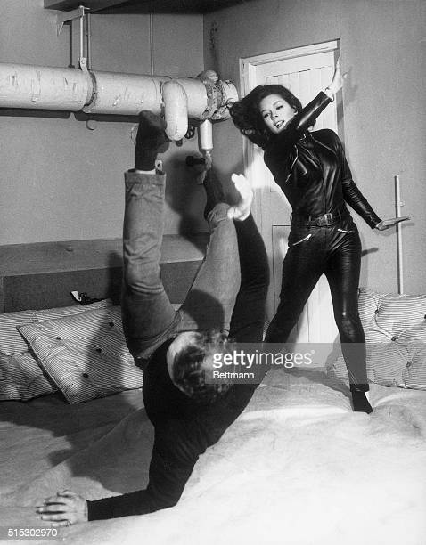 Diana Rigg practices Judo with her instructor in preparation for her role as Emma Peel on The Avengers