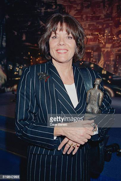 Diana Rigg with her award for Best Actress for 'Medea' at the Evening Standard Theatre Awards held at the Savoy Hotel London 10th November 1992