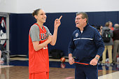 Diana Taurasi and Geno Auriemma of the USA Women's National Team share a laugh during training camp at the University of Connecticut in Storrs...
