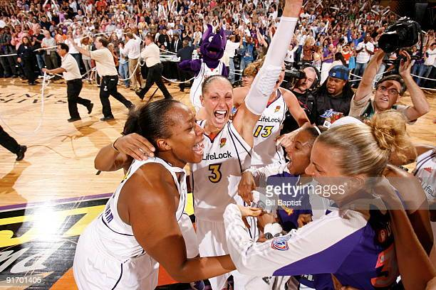 Diana Taurasi and Le'coe Willingham of the Phoenix Mercury celebrates after defeating the Indiana Fever during Game Five of the WNBA Finals on...