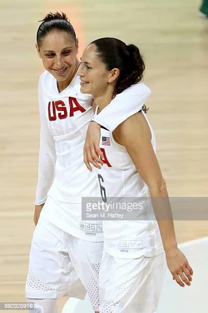 Diana Taurasi and Sue Bird of United States celebrate after winning the Women's Gold Medal Game between United States and Spain on Day 15 of the Rio...