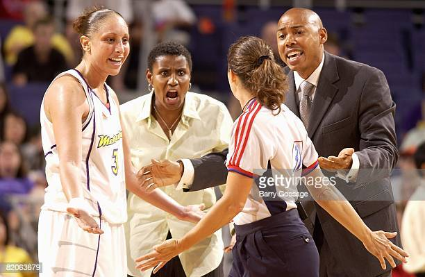Diana Taurasi assistant coach Bridget Pettis and head coach Corey Gaines of the Phoenix Mercury react to a call by referee Amy Bonner during the WNBA...
