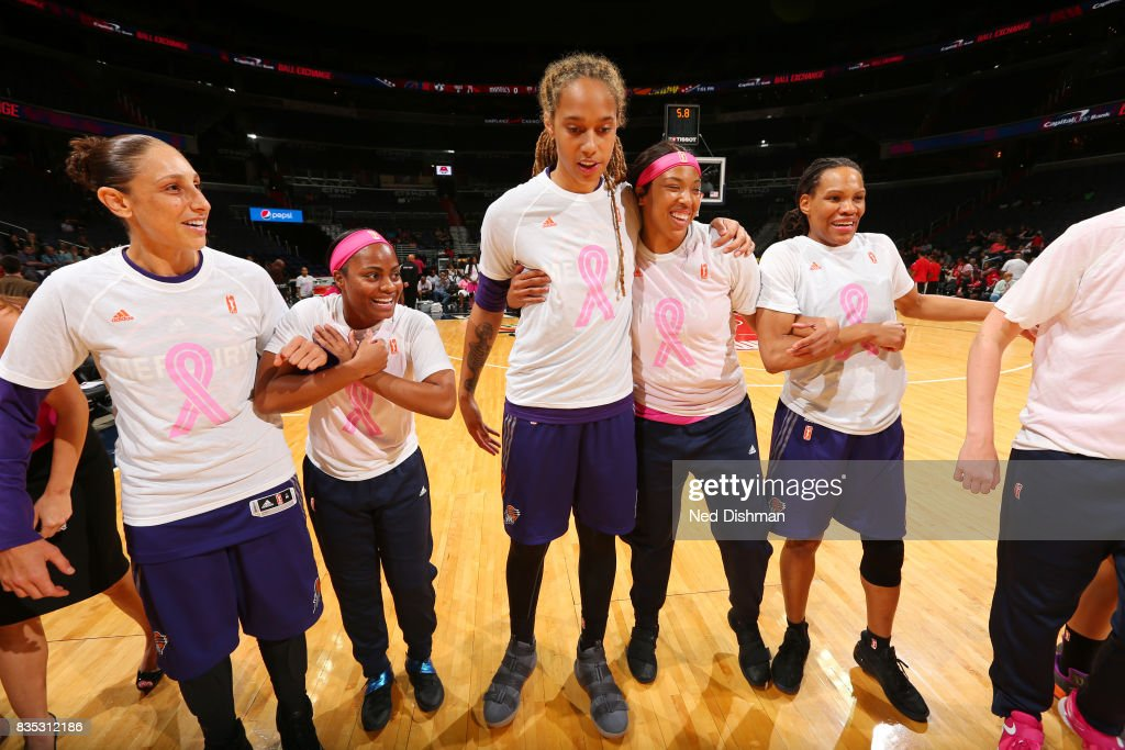 Diana Taurasi #3, Brittney Griner #42, Monique Currie #25 of the Phoenix Mercury hug Ivory Latta #12 and Tianna Hawkins #21 of the Washington Mystics before the game on August 18, 2017 at the Verizon Center in Washington, DC.
