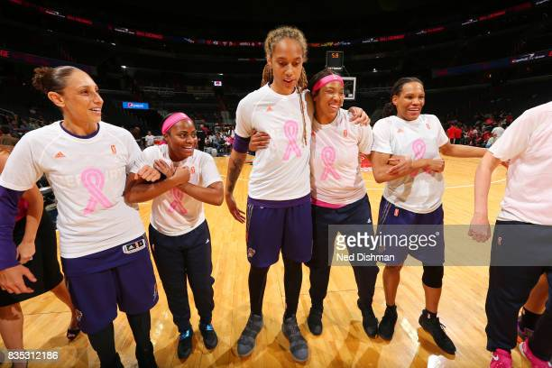 Diana Taurasi Brittney Griner Monique Currie of the Phoenix Mercury hug Ivory Latta and Tianna Hawkins of the Washington Mystics before the game on...