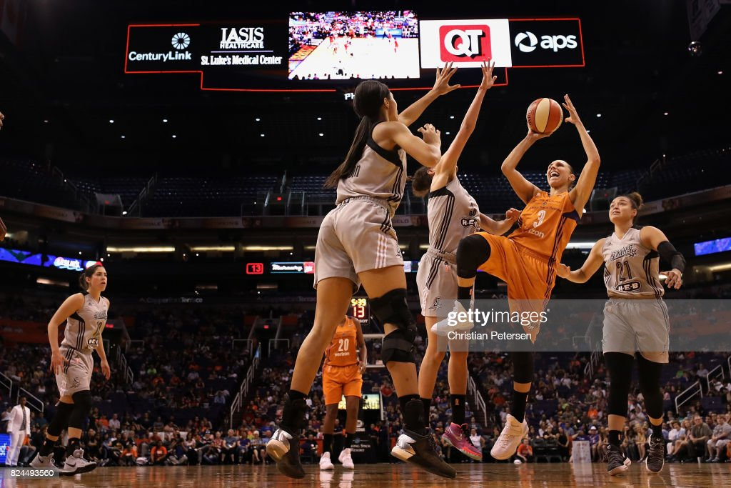 Diana Taurasi #3 of the Phoenix Mercury attempts a shot over Isabelle Harrison #20 of the San Antonio Stars during the first half of the WNBA game at Talking Stick Resort Arena on July 30, 2017 in Phoenix, Arizona. The Mercury defeated the Silver Stars 81-64.