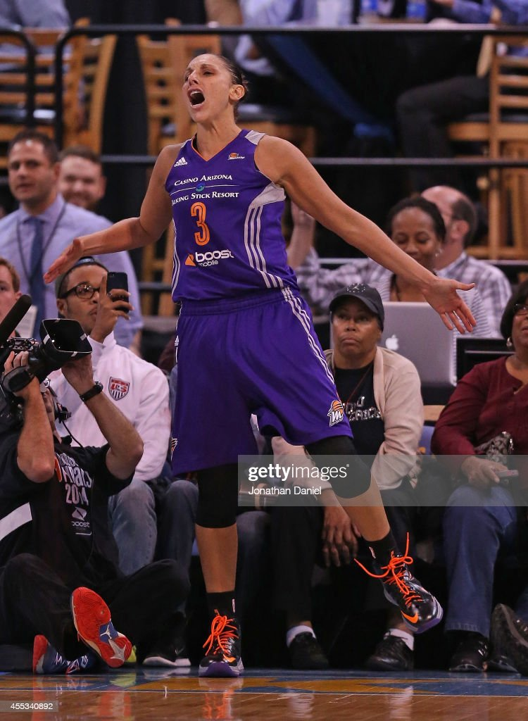Diana Taurasi of the Phoenix Mercury celebrates hitting a shot and drawing a foul against the Chicago Sky during game three of the WNBA Finals at the...