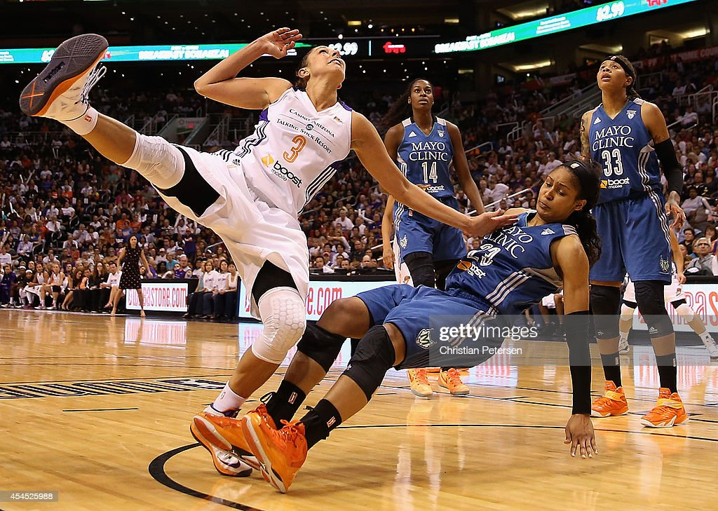 <a gi-track='captionPersonalityLinkClicked' href=/galleries/search?phrase=Diana+Taurasi&family=editorial&specificpeople=202558 ng-click='$event.stopPropagation()'>Diana Taurasi</a> #3 of the Phoenix Mercury collides with <a gi-track='captionPersonalityLinkClicked' href=/galleries/search?phrase=Maya+Moore&family=editorial&specificpeople=4215914 ng-click='$event.stopPropagation()'>Maya Moore</a> #23 of the Minnesota Lynx during the second half of game three of the WNBA Western Conference Finals at US Airways Center on September 2, 2014 in Phoenix, Arizona.